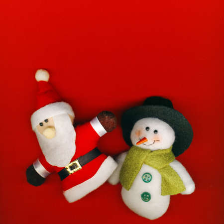 Santa Claus and snowman on the red Christmas background photo