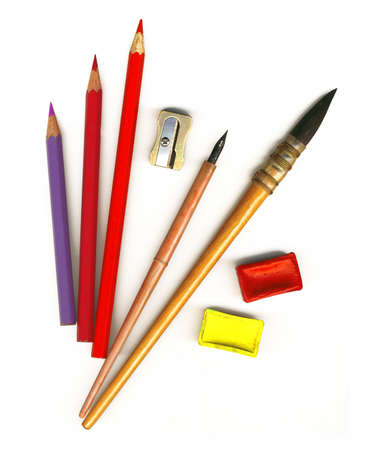 Old paint brushes, watercolors, colored pencils and other tools for drawing photo