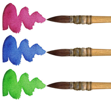 3 brushes with different colours of paint, isolated on white background photo