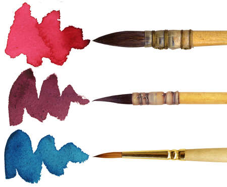 makeup brush: 3 brushes with different colours of paint, isolated on white background