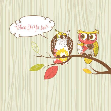 Twee mooie uilen zitten op de tak.