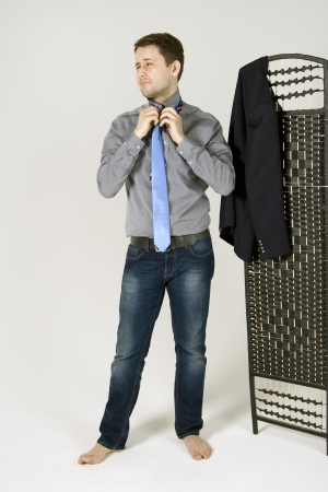 checkroom: man chooses the suit in the wardrobe