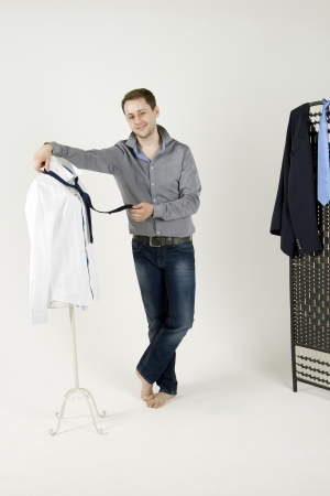 man chooses the suit in the wardrobe