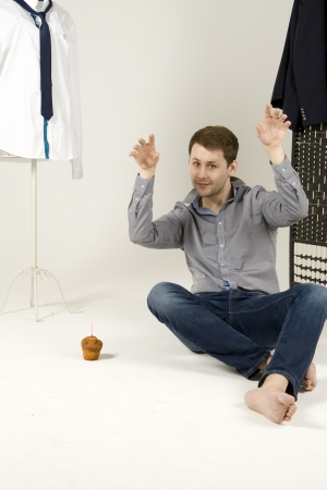 airs: fashion man sits in the chair Stock Photo