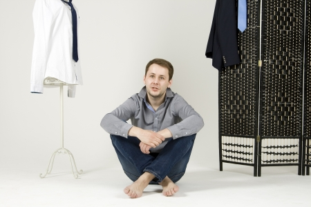 man chooses the suit in the wardrobe Stock Photo - 20311880