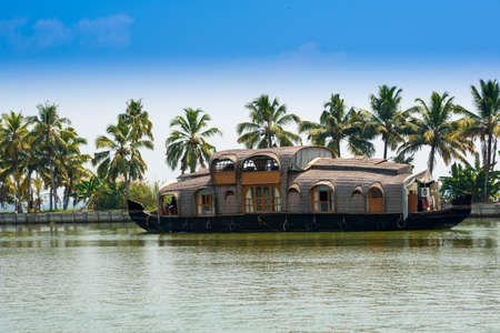houseboat: beautiful landscape with reflection houseboat in kerala backwaters, India