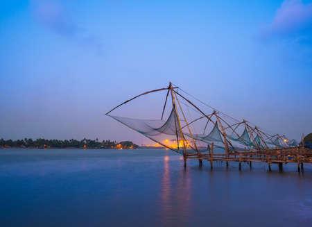 chinese fishing nets: Kochi chinese fishnets in twilight in Kochi, Kerala  Fort Kochin, Kochi, Kerala, India