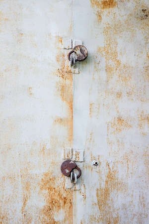 two locks on an iron rusty door Stock Photo - 22031192