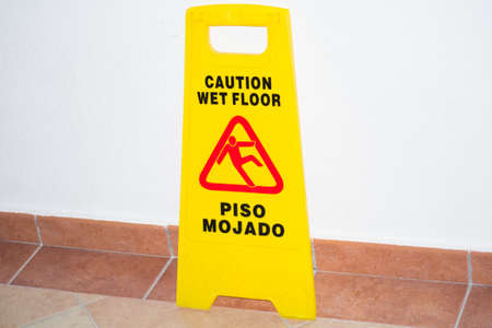 the sign wet floor caution is about a wall photo