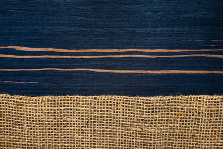 ebony wood: striped ebony wood texture with hessian , rural style