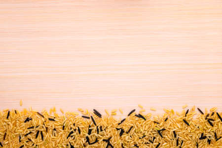 brown and wild rice on a wood background Stock Photo - 24610399