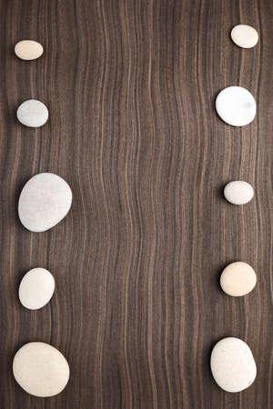 ebony wood: pebbles on ebony wood texture Stock Photo