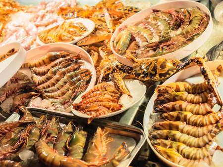 fresh-caught seafood, different types of shrimps photo