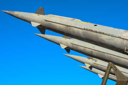 Antiaircraft rockets of a surface-to-air missile system are aimed at the blue sky photo