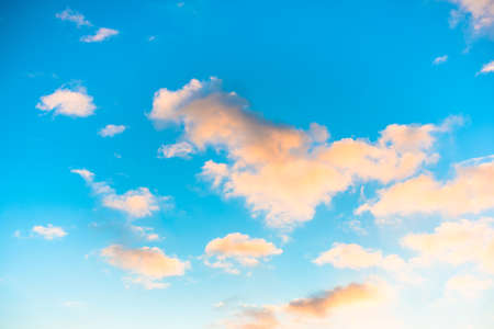 vibrance: blue sky with yellow clouds in the sunrise  Stock Photo