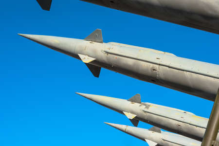 Antiaircraft rockets of a surface-to-air missile system are aimed at the blue sky, closeup  photo