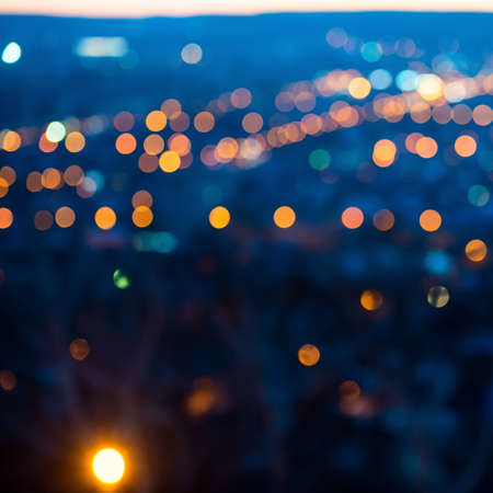 abstract city: city lights in the evening with blurring background