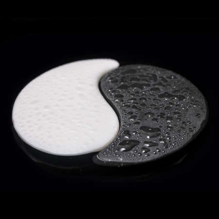 symbol Yin-Yang of stone texture, the sign of the two elements with few on water black background photo