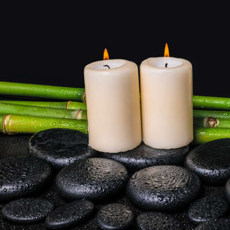 spa concept of zen basalt stones candles and natural bamboo stock