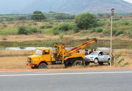 evacuate: TRICHY, INDIA - FEBRUARY 15: After the accident, the car raise evacuate. India, Tamil Nadu, near Trichy. February 15, 2013