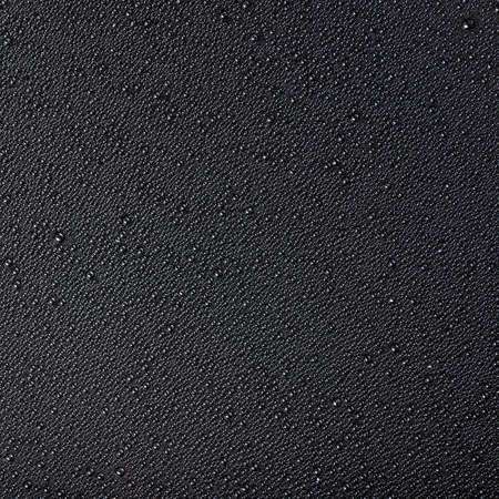bstract: аbstract drops of water on a black background