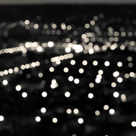 city lights: abstract white black circular bokeh background, city lights in the twilight, closeup