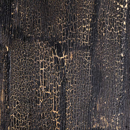 entropy: cracks seamless on black background, painted wooden surface, close up