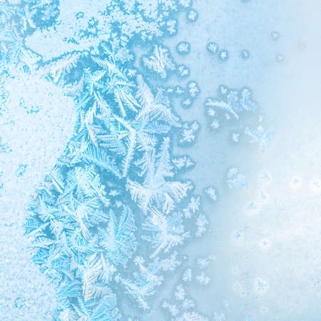 crystallization: abstract winter ice texture on window, festive background, close up