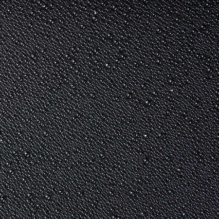 bstract: ?bstract drops of water on a black background, closeup
