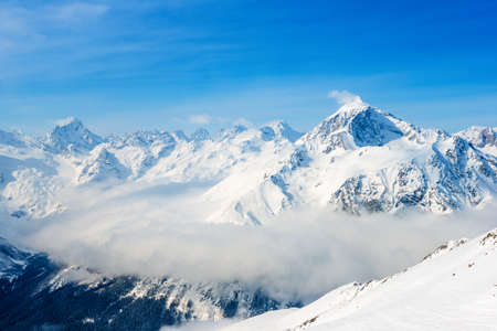pinnacle: beautiful top veiw of Dombaj mountains with clouds and valley, close up