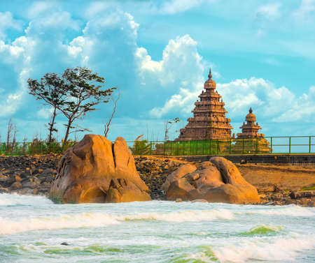 pallava: beautiful landscape of monolithic famous Shore Temple near Mahabalipuram and Indian ocean in Tamil Nadu, India