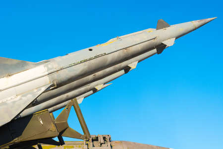 flak: anti aircraft rockets of a surface-to-air missile system are aimed at the blue sky, close up Stock Photo