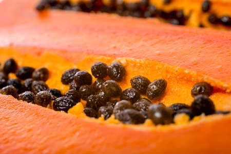 cutaneous: close up fresh slices papaya seeds in the fruit
