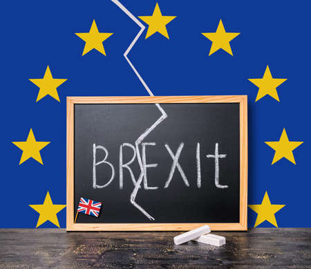 skepticism: Brexit UK EU referendum concept cut Great Britain apart from rest of European union with flags and handwriting text written in chalkboard, close up