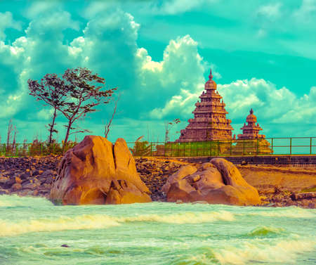 pallava: fantastic art design of beautiful landscape  monolithic famous Shore Temple near Mahabalipuram and Indian ocean in Tamil Nadu, India Stock Photo