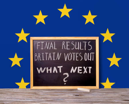 separatism: Brexit UK EU referendum concept for out of Great Britain from rest European union and handwriting text final results Britain votes out what next written in chalkboard on flag background