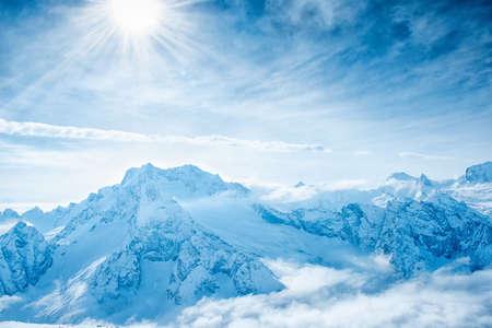 top veiw: beautiful winter landscape of Dombaj mountains higher than clouds, close up, top veiw