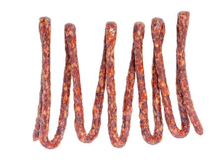 hung: tasty delicious dried bundle red sausages, salami is isolated on white background, close up