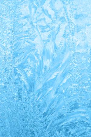 beautiful frost patterns on window, festive background, close up