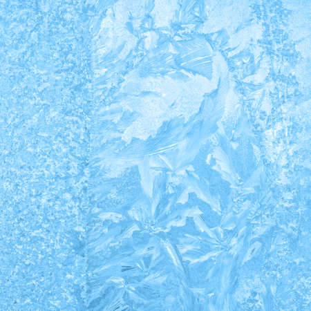 beautiful winter ice, blue texture on window, festive background, close up Stock Photo