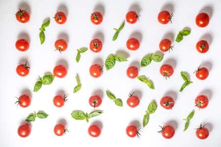 flat lay of beautiful trendy seamless pattern cherry tomato and basil leaves, close up