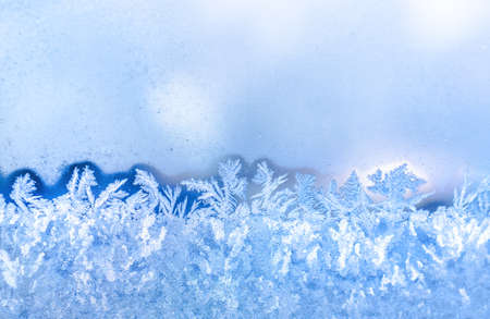 blue frost on window festive background, close up