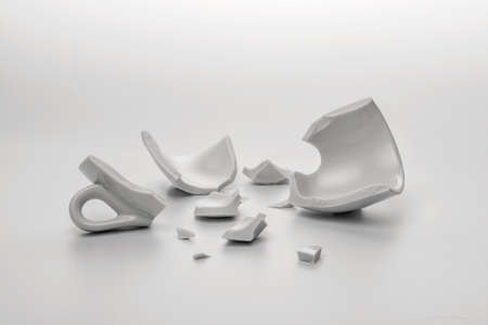 broken white cup with few little pieces, concept disintegration Stok Fotoğraf