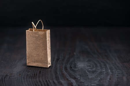 consumerism: single paper bag on wooden background, concept of China Single day Stock Photo