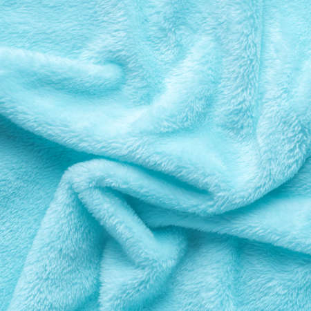 Tender blue texture of towel folded like background