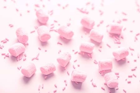 beautiful marshmallows and sprinkles, soft pink background for holidays