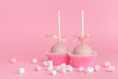 couple festive icing cake pops and marshmallows over pink background, concept of Valentines day Stok Fotoğraf