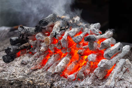 Hot wooden embers with smoke for barbecue Stock Photo