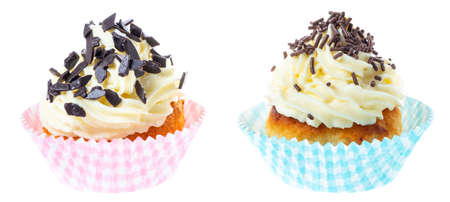 two cupcakes with whipped cream decorated chocolate sprinkles isolated on white background 版權商用圖片
