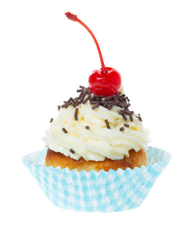 muffin with butter cream decorated chocolate sprinkles and maraschino cherry isolated on white background